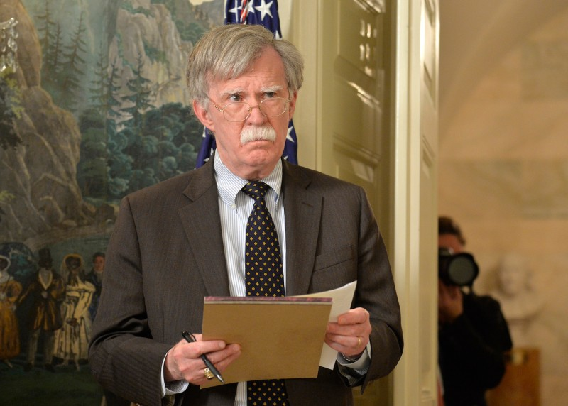 National Security Advisor John Bolton listens to remarks by U.S. President Donald Trump as he announces military action against Syria for an apparent gas attack on its civilians, at the White House on April 13, 2018. (Mike Theiler - Pool/Getty Images)