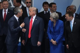NATO Secretary-General Jens Stoltenberg (from left) with U.S. President Donald Trump and British Prime Minister Theresa May at NATO headquarters in Brussels on July 11, 2018. (Sean Gallup/Getty Images)