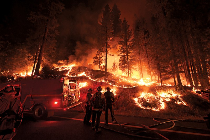 Firefighters try to control a blaze as it spreads toward the towns of Douglas City and Lewiston in California on July 31, 2018. (Mark Ralston/AFP/Getty Images)