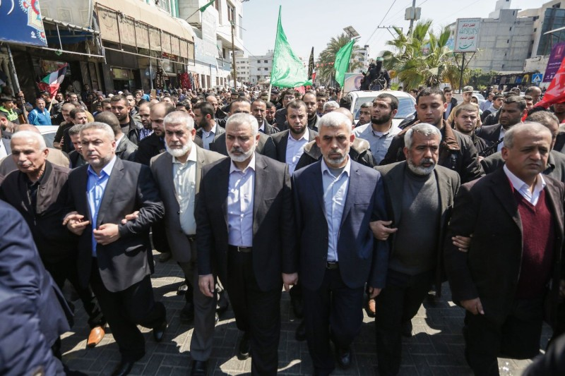 Yahya Sinwar (C-R), the leader of Hamas in the Gaza Strip and Ismail Haniyeh (C-L), the senior leader of the movement's political bureau, attend the funeral of a Hamas official in Gaza City on March 25, 2017.