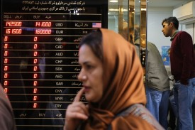 A woman walks past a currency exchange shop in Tehran's grand bazaar on Nov. 3, 2018.