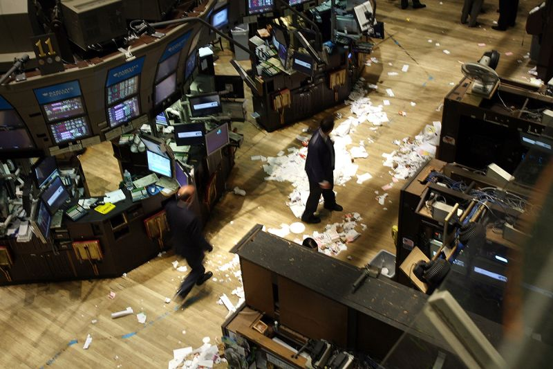 Traders work on the floor of the New York Stock Exchange after the closing bell on Sept. 29, 2008. At the time, the Dow recorded its biggest closing drop in history, falling 777 points.  (Spencer Platt/Getty Images)