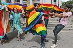 People celebrate in Bangalore on Sept. 6, 2018, after India's top court struck down a colonial-era law that penalized gay sex. (Aijaz Rahi/AP)