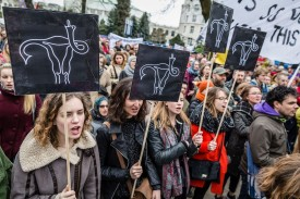 Protesters attend an anti-government demonstration in support of abortion rights in Warsaw on April 9, 2016.