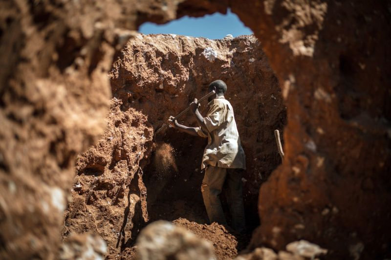 A Congolese man digs through mine waste searching for left over cobalt. May 31, 2015.