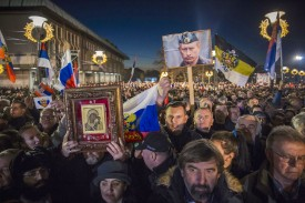 Supporters of Russian President Vladimir Putin wait for his arrival in front of Belgrade's Saint Sava Church on January 17, 2019.