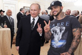 Vladimir Putin poses for a photo with the Kremlin-friendly rapper, Timati, during a meeting with his campaign activists in Moscow, on March 5, 2012.