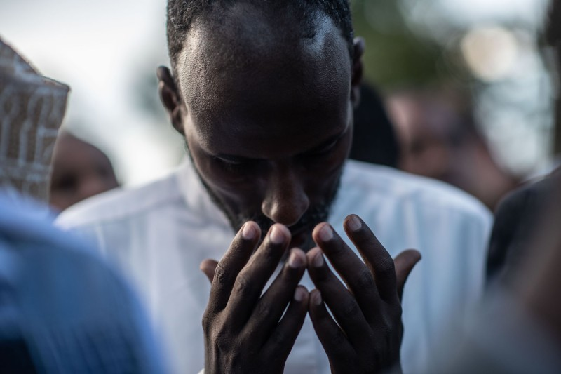 A man prays at the burial of a friend on January 16, 2018 in Nairobi, Kenya after al-Shabab militants stormed the Dusit hotel complex.
