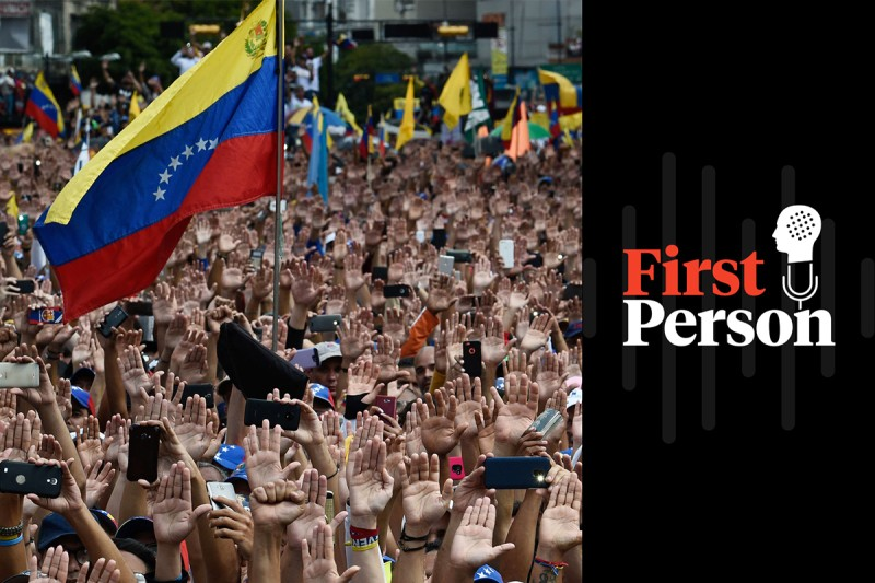 People raise their hands during a mass opposition rally against President Nicolás Maduro, during which Juan Guaidó declared himself Venezuela's acting president, in Caracas on Jan. 23. (Federico Parra/AFP/Getty Images)