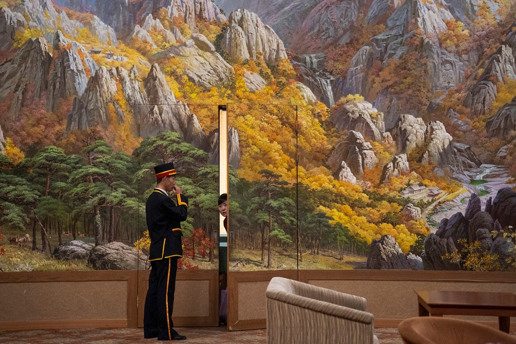 A porter and a woman in the lobby of Kumgangsan Hotel at Mount Kumgang on Sept. 15, 2018. The hotel is the site of reunion meetings between North and South Korean families, which were most recently held in August 2018. (Tariq Zaidi for Foreign Policy)