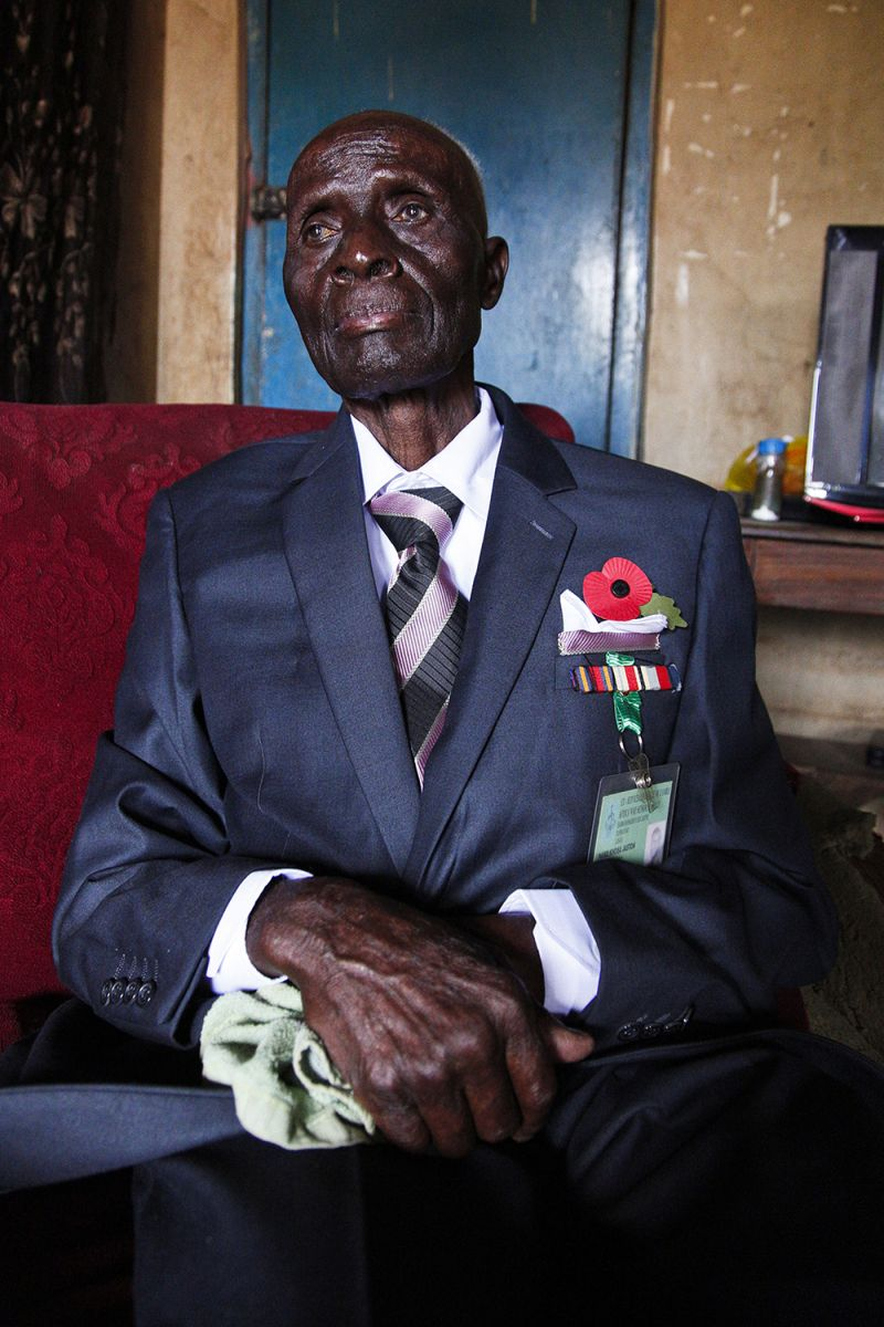 Jaston Khosa, a Zambian in his late 90s and a veteran of Britain's colonial military, on Nov. 27, 2018. Earlier that day, he spoke with Britain's Prince Harry at a veterans meet-and-greet to coincide with Armistice Day commemorations, before returning to his home in a shantytown on the edge of the capital, Lusaka. (Jack Losh for Foreign Policy)