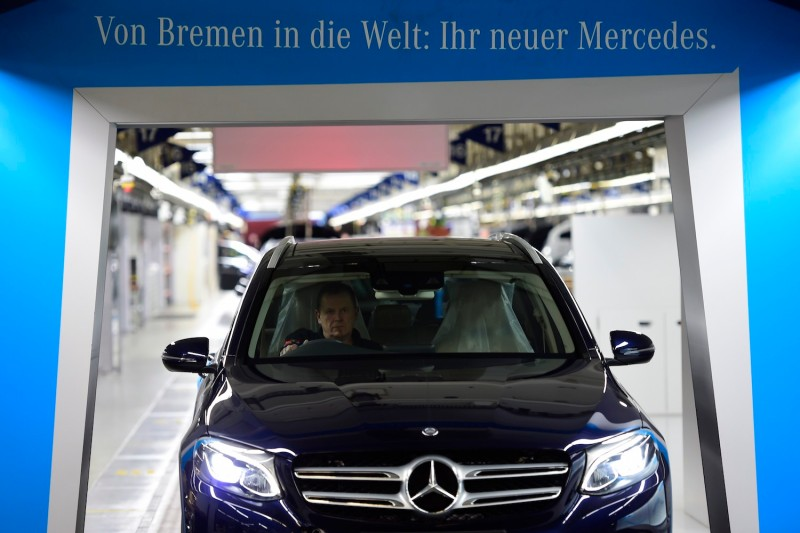 A worker drives a finished Mercedes-Benz C-Class car through production in Bremen, Germany, on Jan. 24, 2017. (Alexander Koerner/Getty Images)