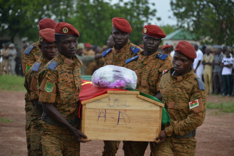 Soldiers carry the coffin of one of the victims during the funeral ceremony of the seven members of the security forces killed after their vehicle struck a roadside bomb in eastern Burkina Faso, on Aug. 31, 2018 in Ouagadougou. (Stringer/AFP/Getty Images)