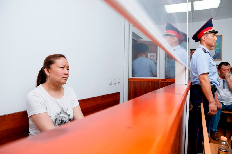Sayragul Sauytbay sits inside a defendants' cage during a hearing at a court in Zharkent, Kazakhstan, on July 13, 2018. (Ruslan Pryanikov/AFP/Getty Images)