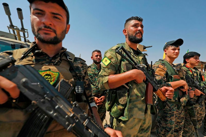 Members of the mostly Kurdish People's Protection Units, part of the Syrian Democratic Forces, gather in the Syrian town of Shadadi on Sept. 11, 2018. (Delil Souleiman/AFP/Getty Images)