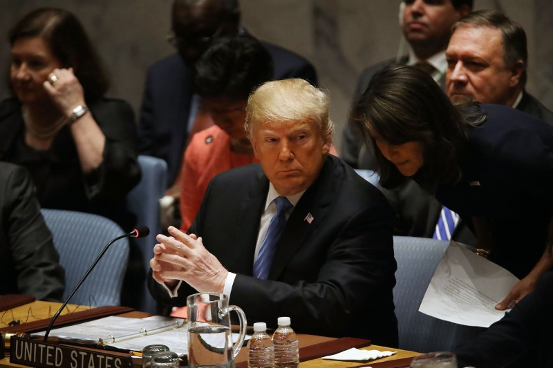 U.S. President Donald Trump speaks with his U.N. ambassador, Nikki Haley, at a United Nations Security Council meeting in New York on Sept. 26, 2018. (Spencer Platt/Getty Images)
