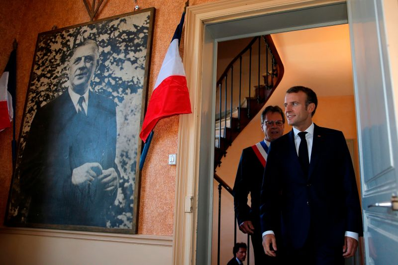 French President Emmanuel Macron looks at a portrait of former French President Charles de Gaulle at the city hall in Colombey-les-Deux-Eglises, France, on Oct. 4, 2018. (Vincent Kessler/AFP/Getty Images)