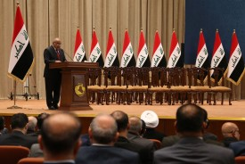 Prime Minister-elect Adel Abdul Mahdi addresses the Iraqi parliament during a vote on the new government in Baghdad on Oct. 24, 2018. (STR/AFP/Getty Images)