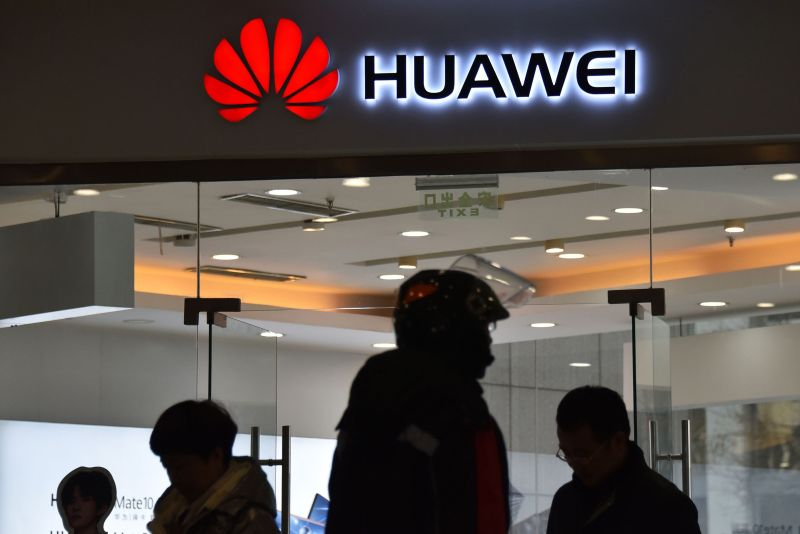 People walk past a Huawei store in Beijing on Dec. 10, 2018. (Greg Baker/AFP/Getty Images)