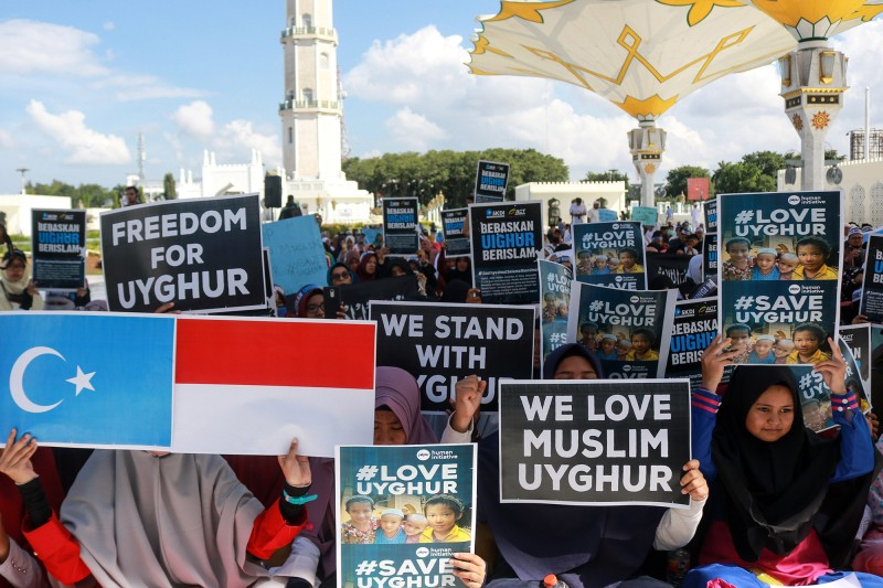 Acehnese Muslims demonstrate against China's oppression of ethnic Uighurs at Baiturrahman Mosque in Banda Aceh, Indonesia, on Dec. 21, 2018. (Riau Images/Barcroft Media via Getty Images)