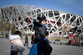 """A family visits the National Stadium, also known as the """"Bird's Nest,"""" constructed for the 2008 Olympic Games in Beijing, on Dec. 26, 2018. (Wang Zhao/AFP/Getty Images)"""