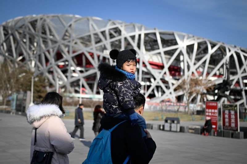 "A family visits the National Stadium, also known as the ""Bird's Nest,"" constructed for the 2008 Olympic Games in Beijing, on Dec. 26, 2018. (Wang Zhao/AFP/Getty Images)"