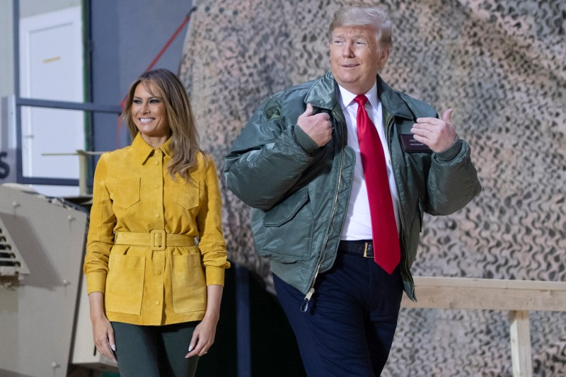 U.S. President Donald Trump and First Lady Melania Trump arrive to speak to members of the U.S. military during an unannounced trip to Al Asad Air Base in Iraq on December 26, 2018. (Photo credit should read SAUL LOEB/AFP/Getty Images)