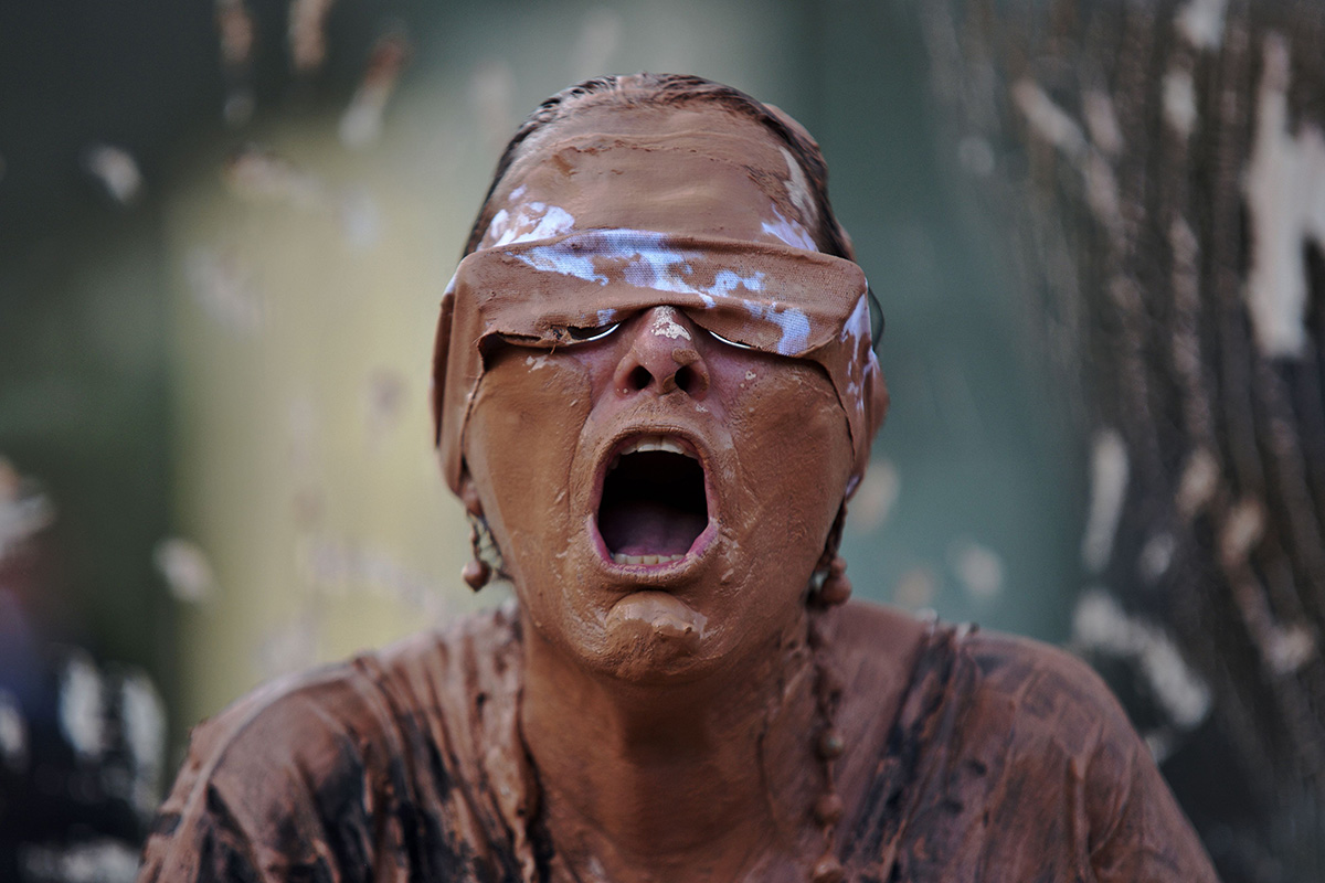 A woman covered in mud protests at a demonstration on Jan. 28 in front of the headquarters of Brazilian mining company Vale in Rio de Janeiro after a deadly dam collapse at an iron-ore mine owned by the company. (Fabio Teixeira/AFP/Getty Images)