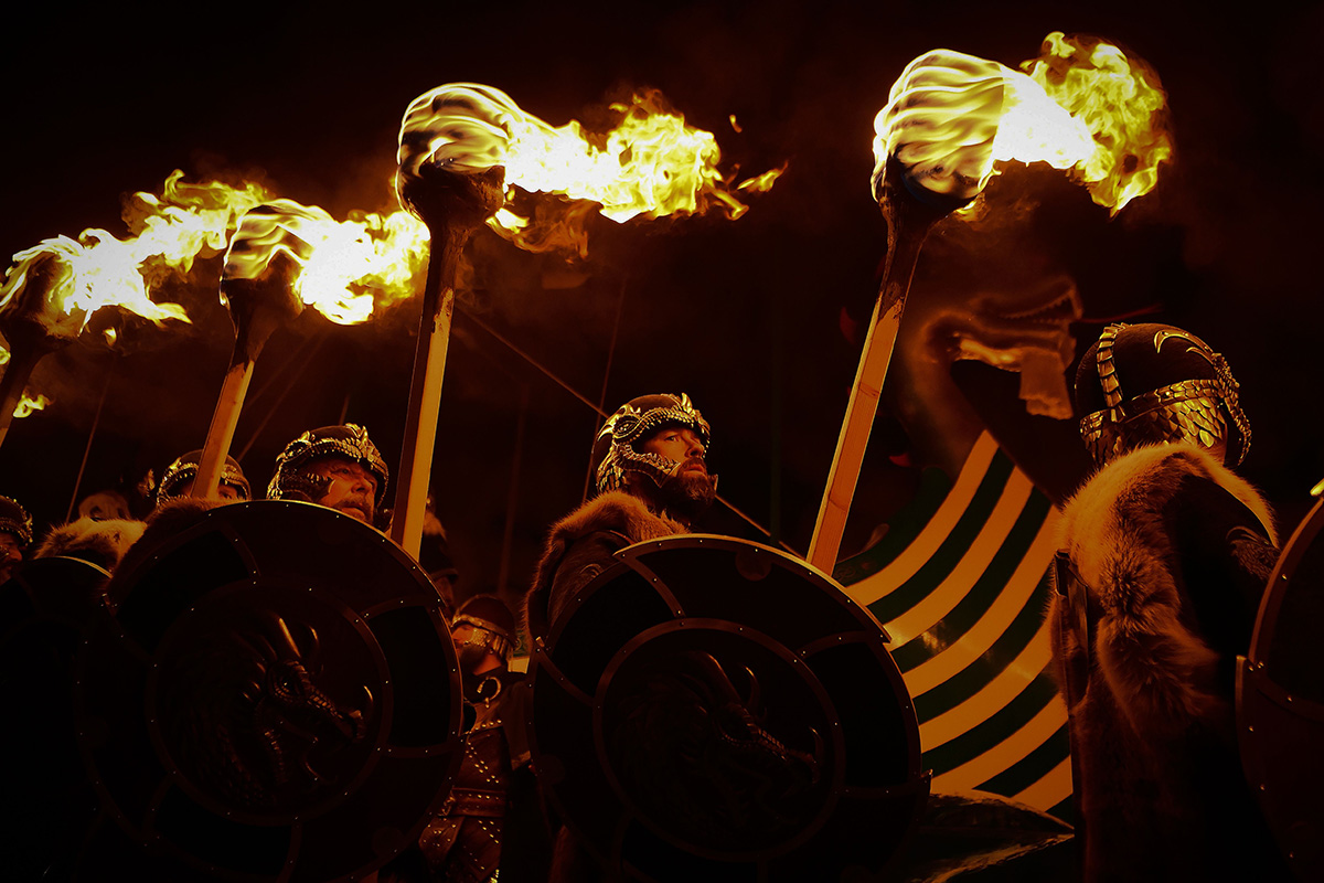 "Men dressed as Vikings gather with burning brands as they take part in the Up Helly Aa festival in Lerwick, Shetland Islands, on Jan. 29.  The festival celebrates the influence of Scandinavian Vikings in the Shetland Islands and culminates with up to 1,000 ""guizers"" (men in costume) throwing flaming torches into their Viking longboat and setting it alight. (Andy Buchanan/AFP/Getty Images)"