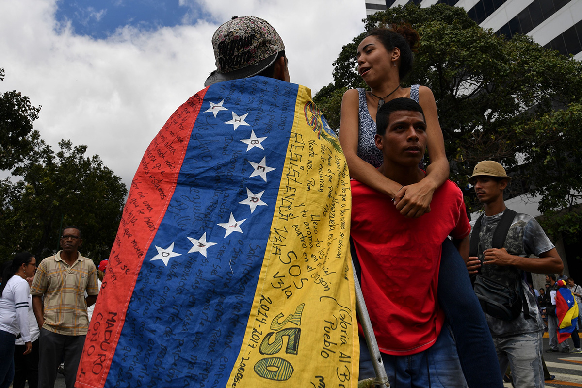 Opposition demonstrators protest the government of President Nicolás Maduro, called by opposition leader and self-proclaimed acting president Juan Guaidó, at Altamira square in Caracas on Jan. 30. (Yuri Cortez/AFP/Getty Images)