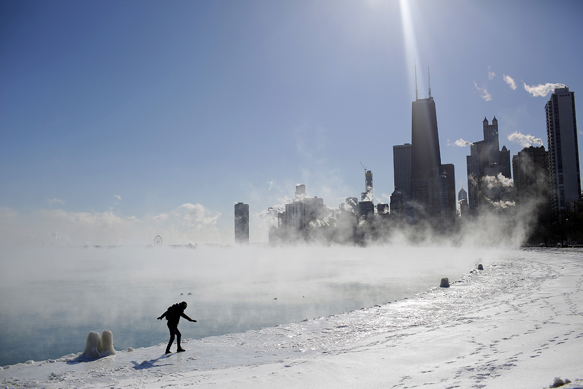 Marius Radoi balances as he walks on the edge of Lake Michigan's shore line as temperatures dropped to negative 20 degrees Fahrenheit in Chicago on Jan. 30. (Joshua Lott/AFP/Getty Images)