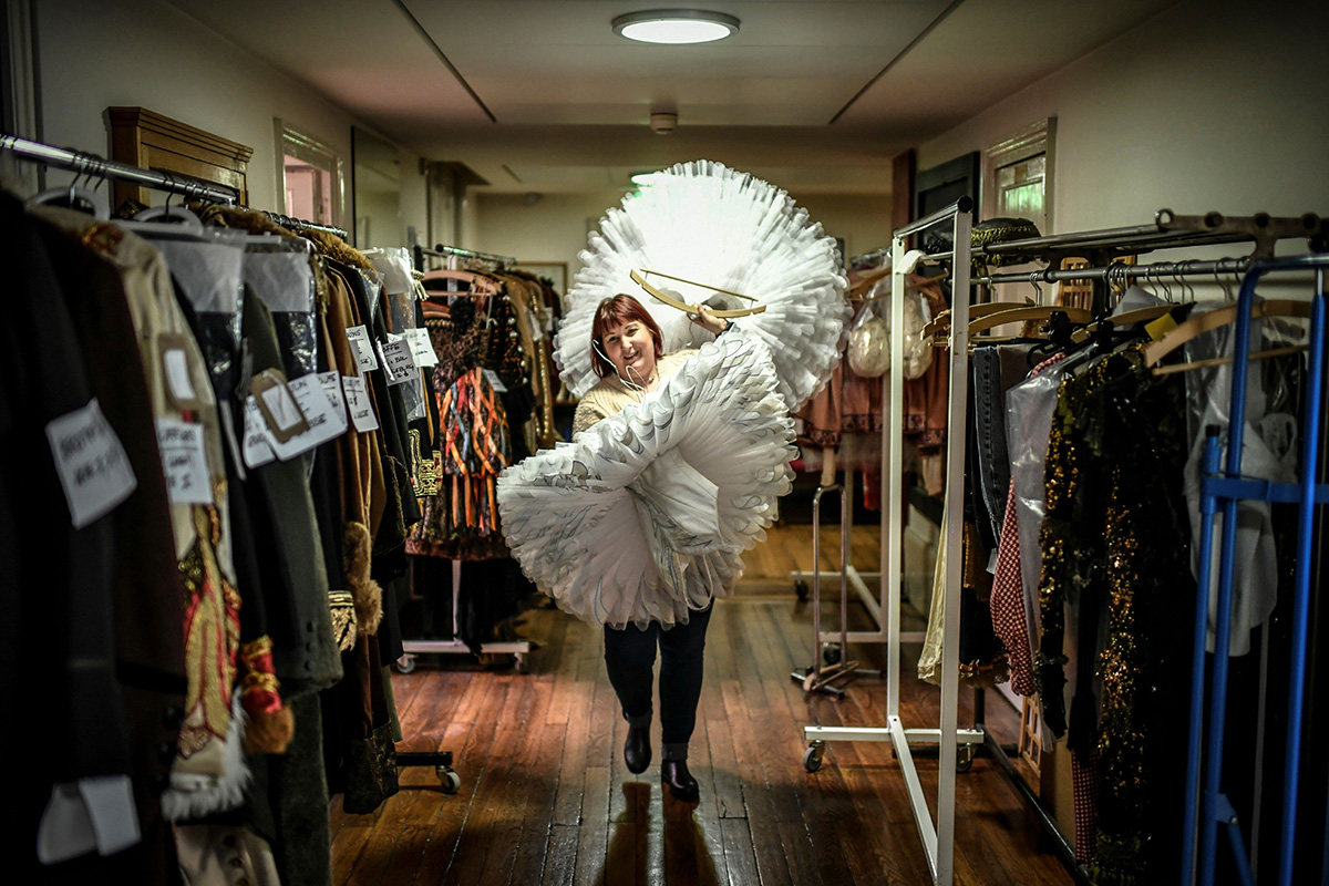 A costume designer carries tutus in the costume department at the Opera Garnier in Paris on Jan. 30. (Stephane de Sakutin/AFP/Getty Images)
