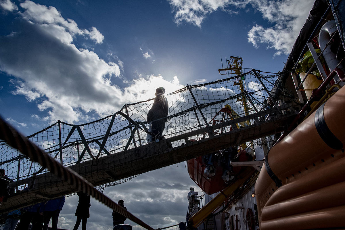 A migrant disembarks from the Dutch-flagged rescue vessel after it docked in Catania, Italy, on Jan. 31. The ship carrying 47 rescued migrants docked in the Sicilian port with the crew fearing legal action as Italy's far-right interior minister tries to stop new arrivals. FEDERICO SCOPPA/AFP/Getty Images