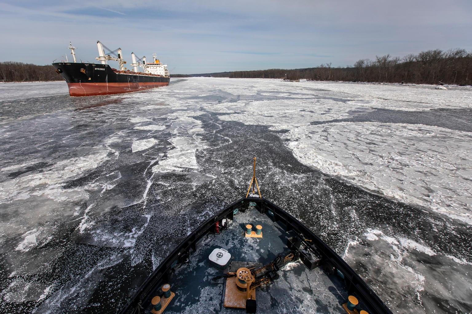 The USCGC Penobscot Bay, an icebreaking tugboat of the U.S. Coast Guard, cuts through ice as it makes its way north on the Hudson River between the cities of Kingston and Albany, N.Y., on Feb. 1. (Drew Angerer/Getty Images)