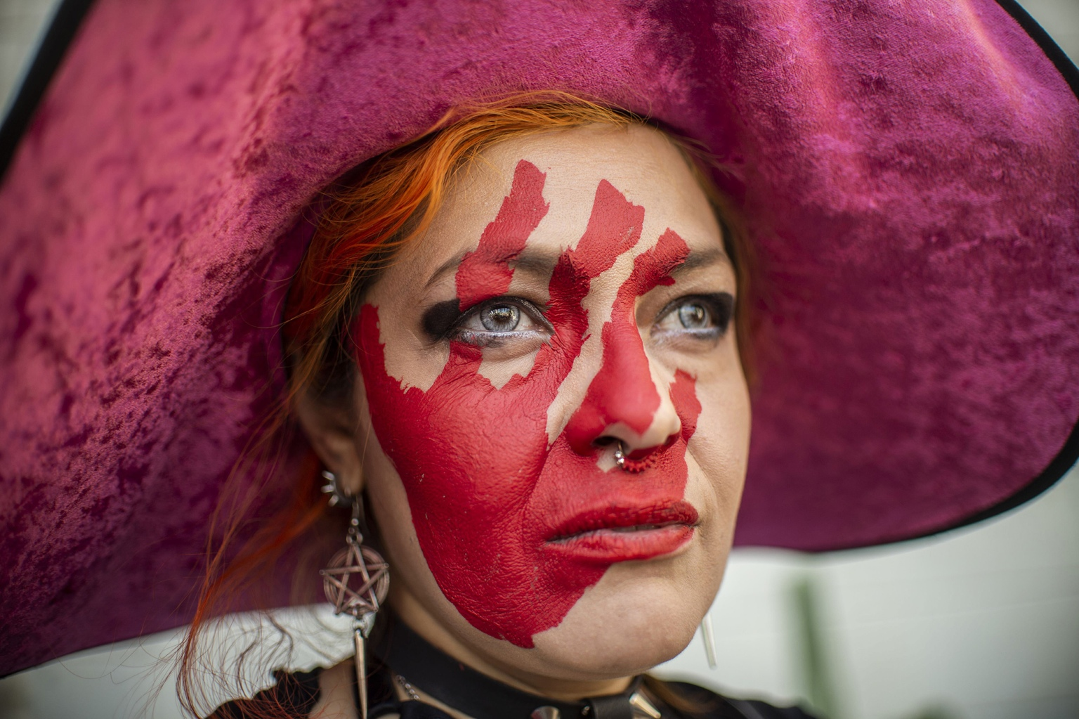 A woman takes part in a protest against gender violence and femicides in Mexico City on Feb. 2. (Pedro Pardo/AFP/Getty Images)
