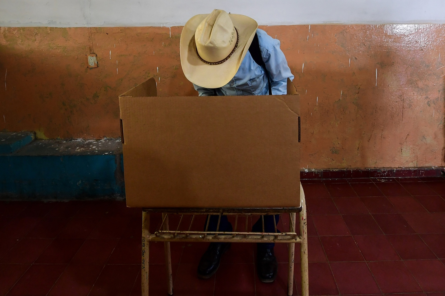 A farmer votes at a polling station in the Bernardino Villamarion School in Panchimalco, during the Salvadorean presidential election, on Feb. 3. (Luis Acosta/AFP/Getty Images)