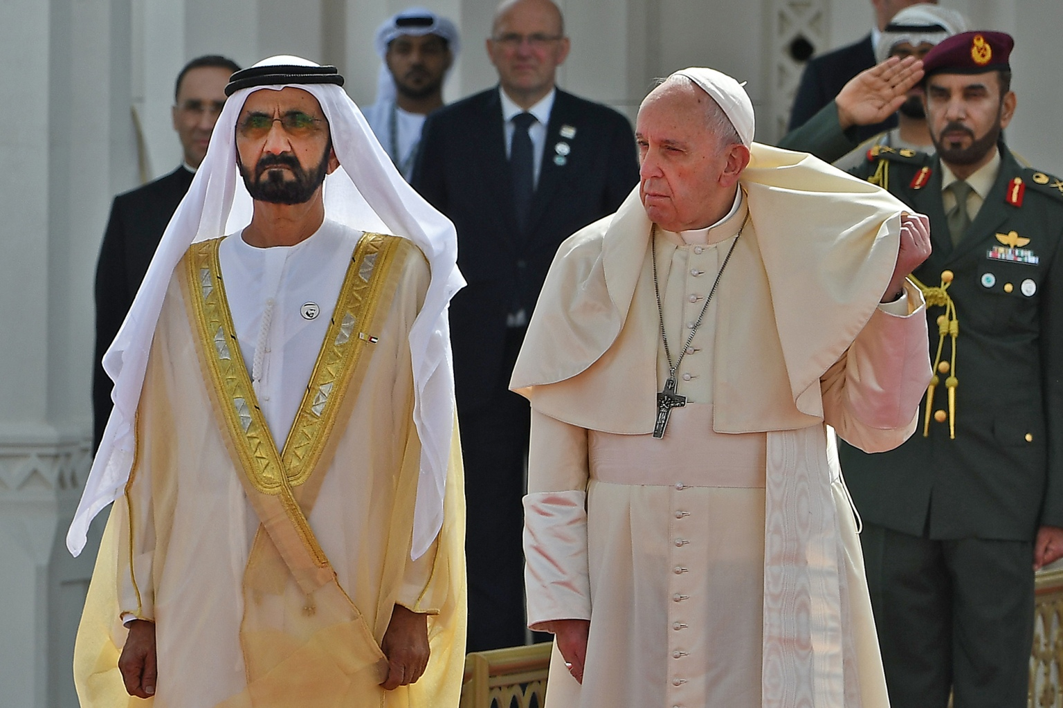 Pope Francis is welcomed by Dubai ruler Sheikh Mohammed bin Rashid Al-Maktoum and  Abu Dhabi's Crown Prince Mohammed bin Zayed al-Nahyan upon his arrival to the presidential palace in Abu Dhabi on Feb. 4. It was the first ever papal visit to the Arabian Peninsula, birthplace of Islam, where he will meet leading Muslim clerics and hold an open-air Mass for some 135,000 Catholics. (Vincenzo Pinto/AFP/Getty Images)