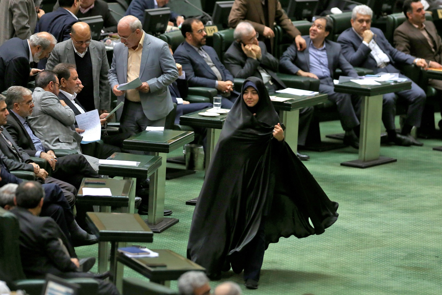 An Iranian lawmaker walks through a parliament session in Tehran on Feb. 4. (Atta Kenare/AFP/Getty Images)
