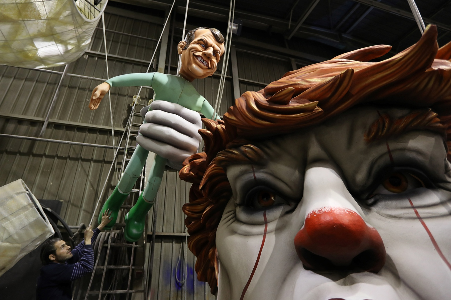 People prepare for the 135rd Nice Carnival in southeastern France on Feb. 4. (Valery Hache/AFP/Getty Images)