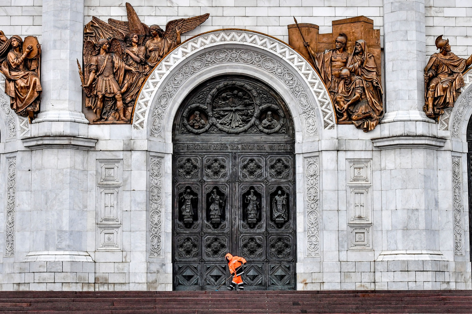 A municipal worker clears the ice from the steps of the Cathedral of Christ the Savior in downtown Moscow on Feb. 5. (Yuri Kadobnov/AFP/Getty Images)