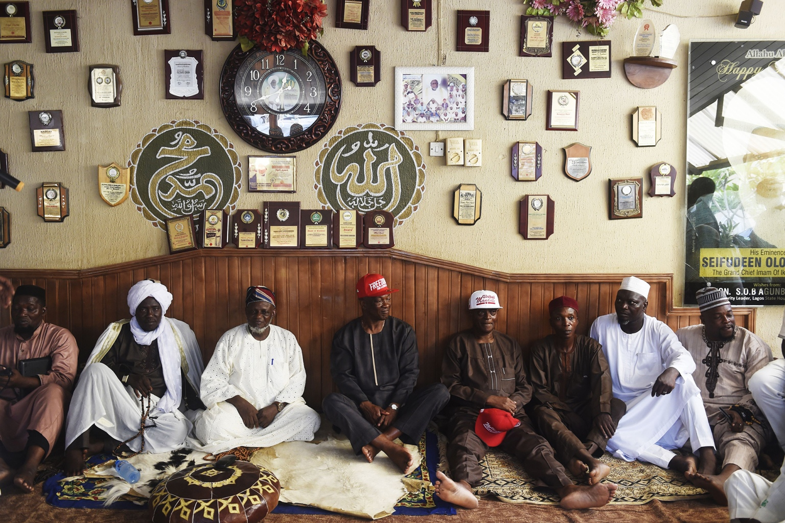 Nigerian opposition Peoples Democratic Party gubernatorial candidate Jimi Agbaje (center) sits on the floor during a meeting with Islamic leaders in the Ikorodu district of Lagos on Feb. 5. (Pius Utomi Ekpei/AFP/Getty Images)