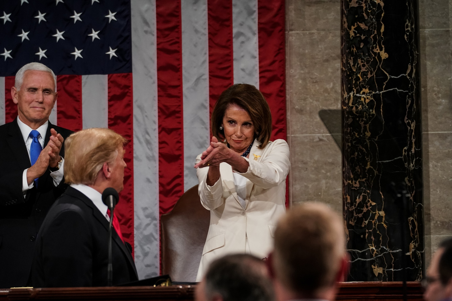 Speaker of the House Nancy Pelosi and Vice President Mike Pence applaud U.S. President Donald Trump at his State of the Union address in Washington on Feb. 5. (Doug Mills/Getty Images)