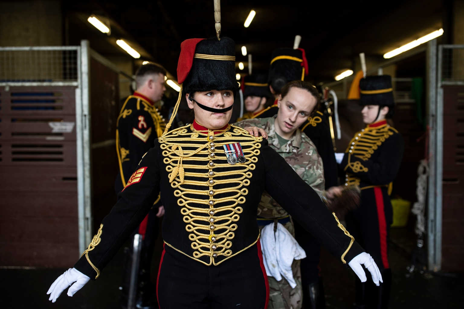Members of the King's Troop Royal Horse Artillery prepare their ceremonial dress at Wellington Barracks before heading to Green Park to stage a 41-gun salute to mark 67 years since HM Queen Elizabeth II's ascension to the throne in London on Feb. 6. (Dan Kitwood/Getty Images)