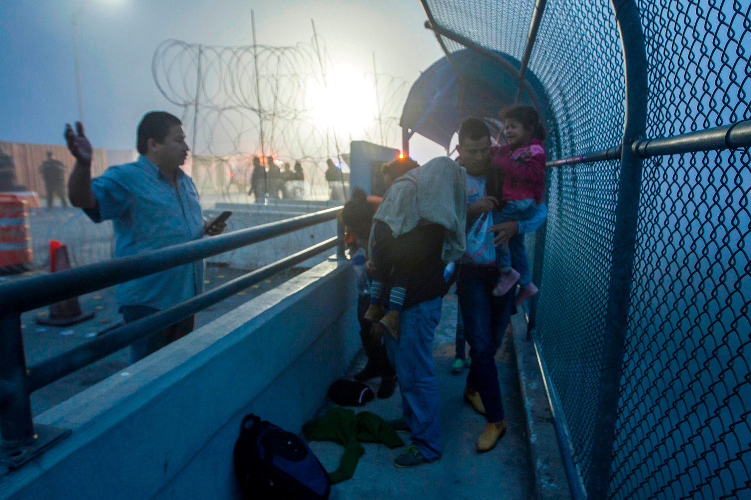 A Honduran family walks back to Piedras Negras, in Coahuila state, Mexico, at the international bridge after being rejected by U.S. authorities in their attempt to enter Eagle Pass, Texas, on Feb. 6. (Julio Cesar Aguilar/AFP/Getty Images)