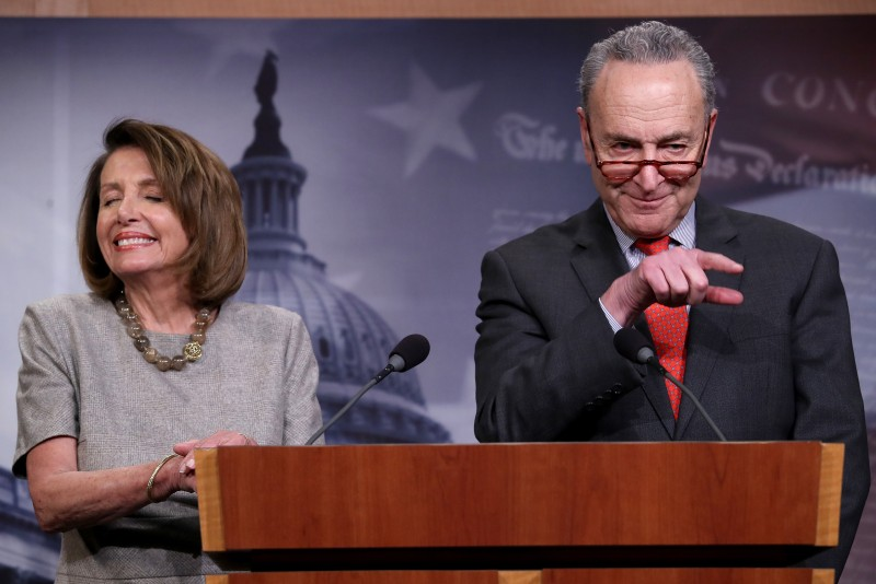 Speaker of the House Nancy Pelosi and Senate Minority Leader Chuck Schumer answer questions following an announced end to the partial government shutdown at the U.S. Capitol in Washington on Jan. 25. (Win McNamee/Getty Images)
