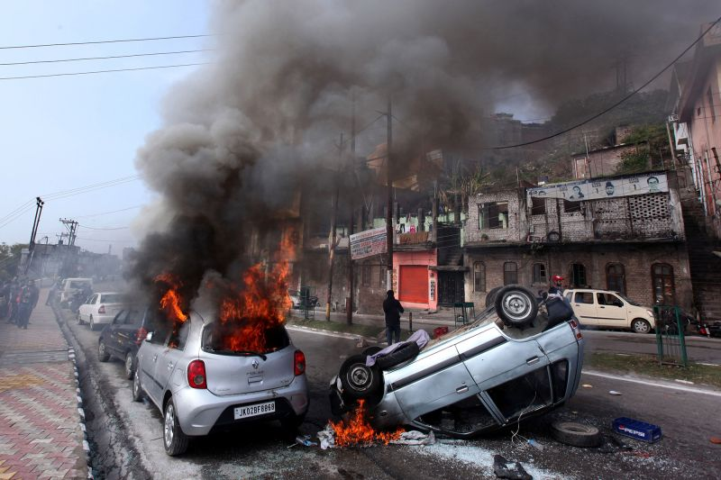 Vehicles burn along a road during a protest in Jammu on Feb. 15, the day after an attack on a Central Reserve Police Force convoy in Pulwama, Kashmir. (Rakesh Bakshi/AFP/Getty Images)