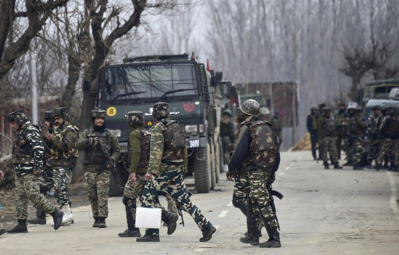 Indian security forces in Kashmir, some six miles away from the spot of a recent suicide bombing, on Feb. 18. (STR/AFP/Getty Images)