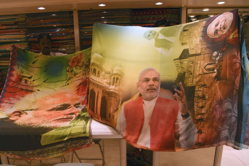 Sarees bearing the image of Indian Prime Minister Narendra Modi at a shop in Mumbai on Feb. 19. (Indranil Mukherjee/AFP/Getty Images)