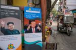 Signs depicting U.S. President Donald Trump and North Korean leader Kim Jong Un in Hanoi on Feb. 20. (Linh Pham/Getty Images)