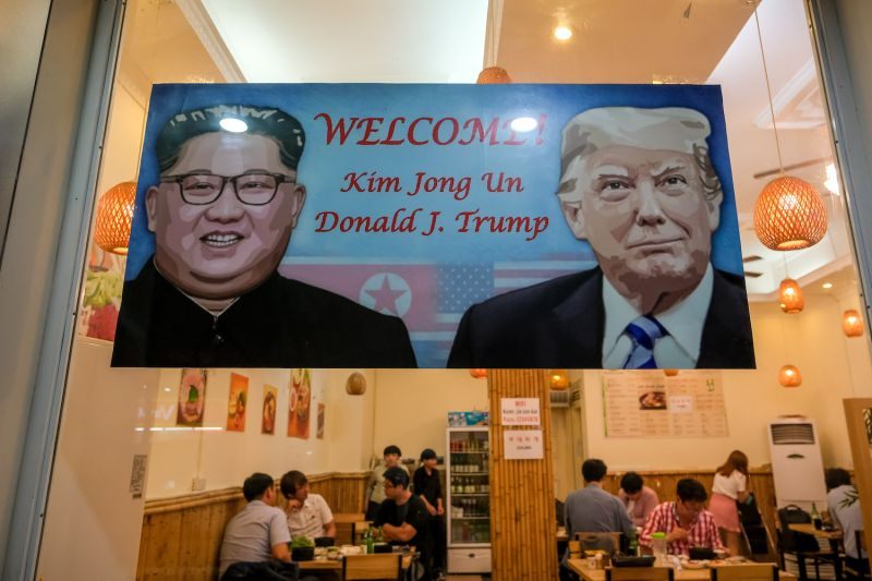 A signboard welcomes the upcoming summit between U.S. President Donald Trump and North Korean leader Kim Jong Un at a restaurant in Tu Liem District in Hanoi on Feb. 20. (Linh Pham/Getty Images)